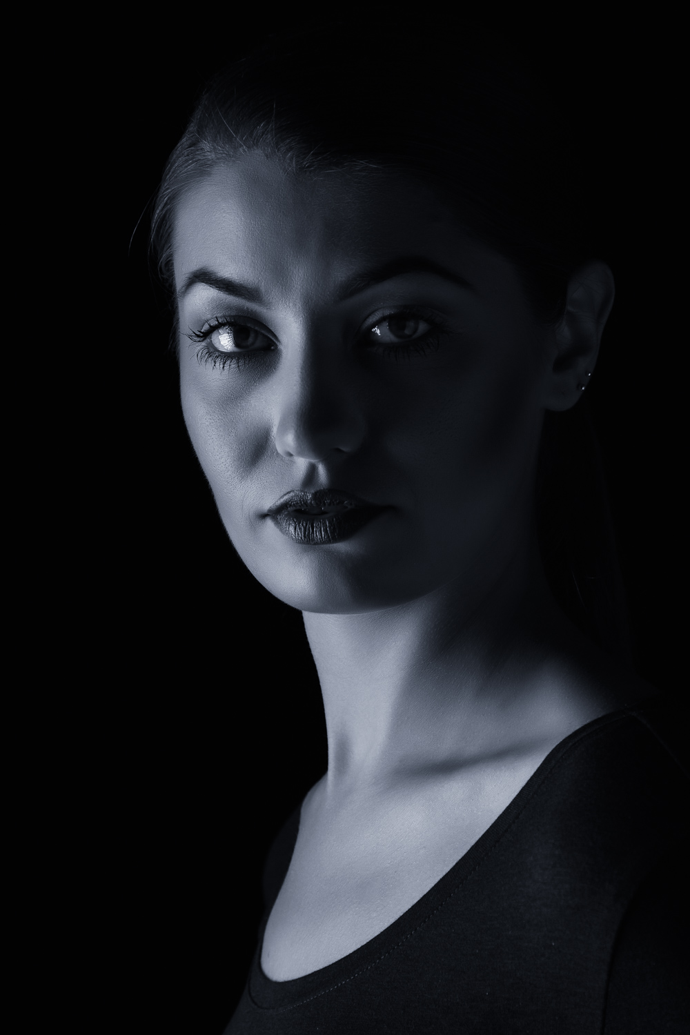 Low key portrait - using only one softbox in the studio. Photo: john Einar Sandvand