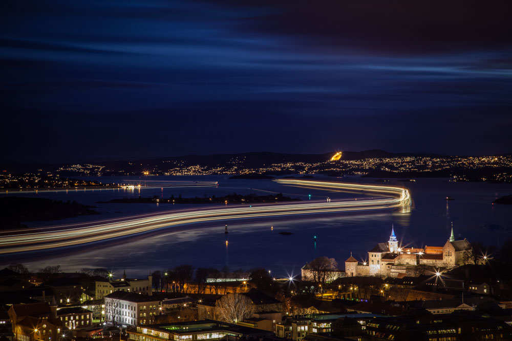 Ferry leaving Oslo. The photo is taken from the rooftop of Postgirobygget - and is composed of a series of 5 minutes exposures. All in all it covered the ferry trip for around 40 minutes. Photo: John Einar Sandvand